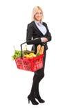 Young woman holding a shopping basket stock photos