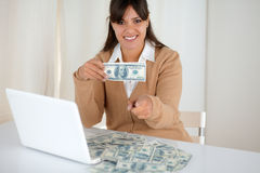 Young woman holding and showing you cash dollars Stock Photography