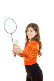 Young woman holding shuttlecock and racket playing badminton Royalty Free Stock Image