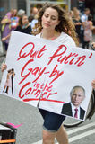 Young woman holding sign against president putins law on gay rights Stock Photo
