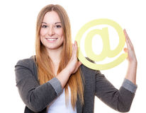 Young woman holding at sign Stock Images