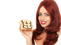 Young Woman Holding a Slice of Chocolate Spread and Banana on Toast Royalty Free Stock Photography