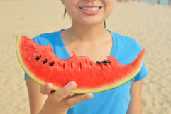 Young woman holding slice of watermelon and smiling Royalty Free Stock Photography
