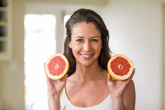 Young woman holding slices of blood orange Royalty Free Stock Images