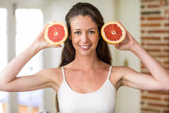 Young woman holding slices of blood orange Stock Image