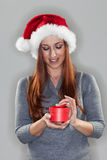 Young woman holding a small Christmas gift Stock Photo