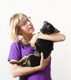 Young woman holding small dog Stock Image
