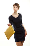Young woman holding small parcel Royalty Free Stock Image