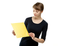 Young woman holding small parcel Stock Photo