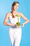 Young Woman holding a small tree Royalty Free Stock Photo
