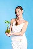 Young Woman holding a small tree Stock Images