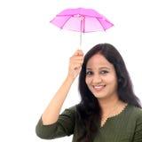 Young woman holding small umbrella - Money saving Royalty Free Stock Photo
