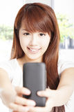 Young woman holding  smart phone Royalty Free Stock Image