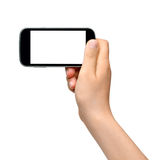 Young woman holding smartphone Stock Photography