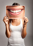 Young woman holding a smile Royalty Free Stock Photography