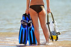 Young woman holding snorkeling equipment Stock Photography