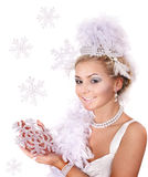 Young woman holding snowflake. Royalty Free Stock Images