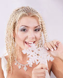 Young woman holding snowflake. Stock Images
