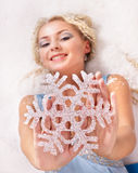 Young woman holding snowflake. Stock Image