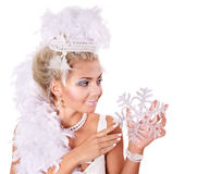 Young woman holding snowflake. Royalty Free Stock Photo