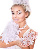 Young woman holding snowflake. Royalty Free Stock Photography