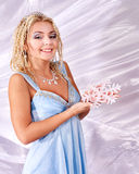 Young woman holding snowflake. Stock Photography