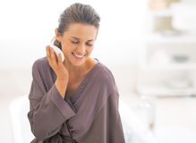 Young woman holding soap in bathroom Royalty Free Stock Images