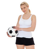 Young woman holding soccer ball Royalty Free Stock Image