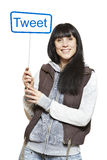 Young woman holding a social media sign smiling Stock Image