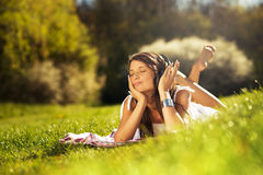 Young woman holding some flowers happily Stock Photos