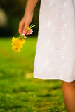 Young woman holding some flowers. Smiling young woman holding some flowers happily Stock Images