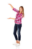 Young woman holding something between her hands Royalty Free Stock Image