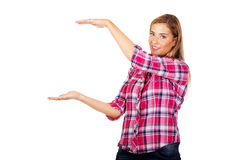 Young woman holding something between her hands Royalty Free Stock Photography