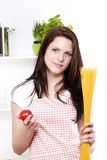 Young woman holding spaghetti and tomato Stock Photos