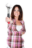 Young woman holding spanner Royalty Free Stock Photography