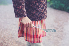 Young woman holding a spatula Royalty Free Stock Photo