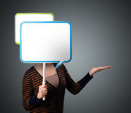 Young woman holding speech bubble Stock Photography