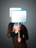 Young woman holding speech bubble Royalty Free Stock Photo