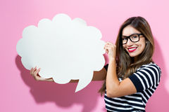 Young woman holding a speech bubble Stock Photography
