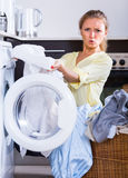 Young woman holding stained linen Stock Photo