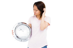 Young woman holding stainless steel clock Royalty Free Stock Image