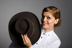 Young woman holding a stetson Royalty Free Stock Image
