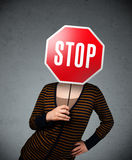 Young woman holding a stop sign Royalty Free Stock Images