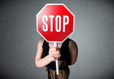 Young woman holding a stop sign Stock Photos