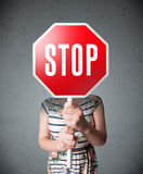 Young woman holding a stop sign Royalty Free Stock Photos