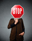 Young woman holding a stop sign Stock Image