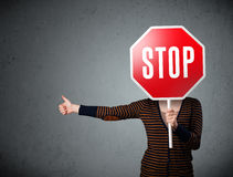 Young woman holding a stop sign Stock Photo