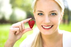 Young woman holding strawberry Royalty Free Stock Photography
