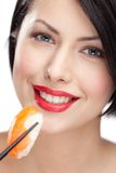 Young woman holding sushi Royalty Free Stock Photo