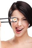 Young woman holding sushi roll with a chopsticks Royalty Free Stock Images
